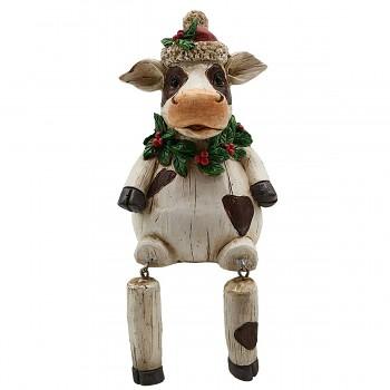 Sedící kravička ve vánoční čepici